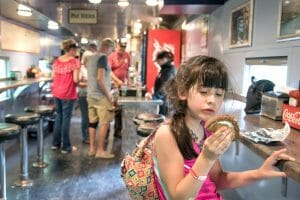 Alice having a snack on the Great Smoky Mountain Railroad which is one of the best things to do in Bryson City, NC