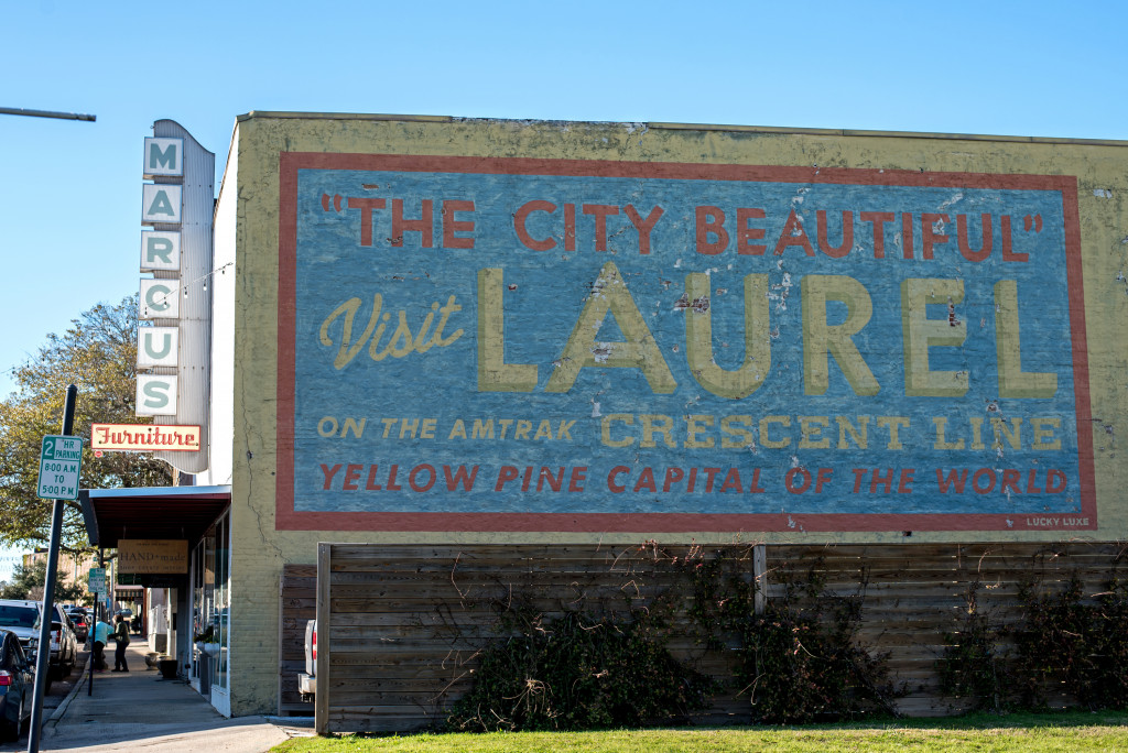 Beautiful Laurel, Mississippi was once known as the yellow pine capitol of the world. This is a mural on a building near the train tracks in Laurel calling it the city beautiful.