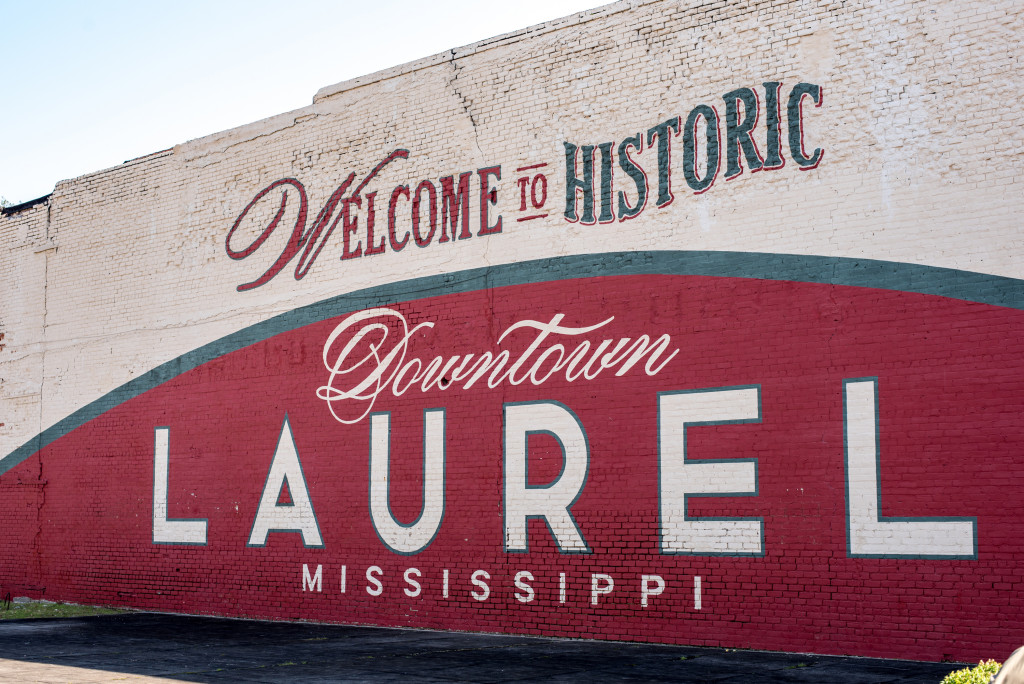 A large wall mural in Laurel, Mississippi. Laurel is home to the television show on HGTV called Home Town. This mural is on the side of a building at one of the main roads entering the down town area.