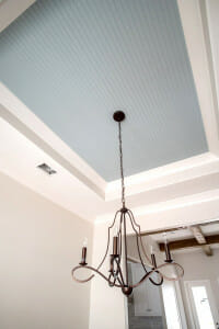 Interior bead board ceiling painted blue. Ideas for southern porch decor.