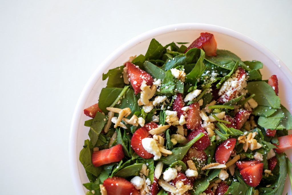 A list of the best strawberry recipes for the summer! This is a strawberry spinach salad with candies almonds and creamy feta. It is delicious on its own or with some chicken on top.
