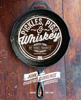 Pickles, pigs, and whiskey a cookbook by chef John Currence is one of the essential southern cookbooks.