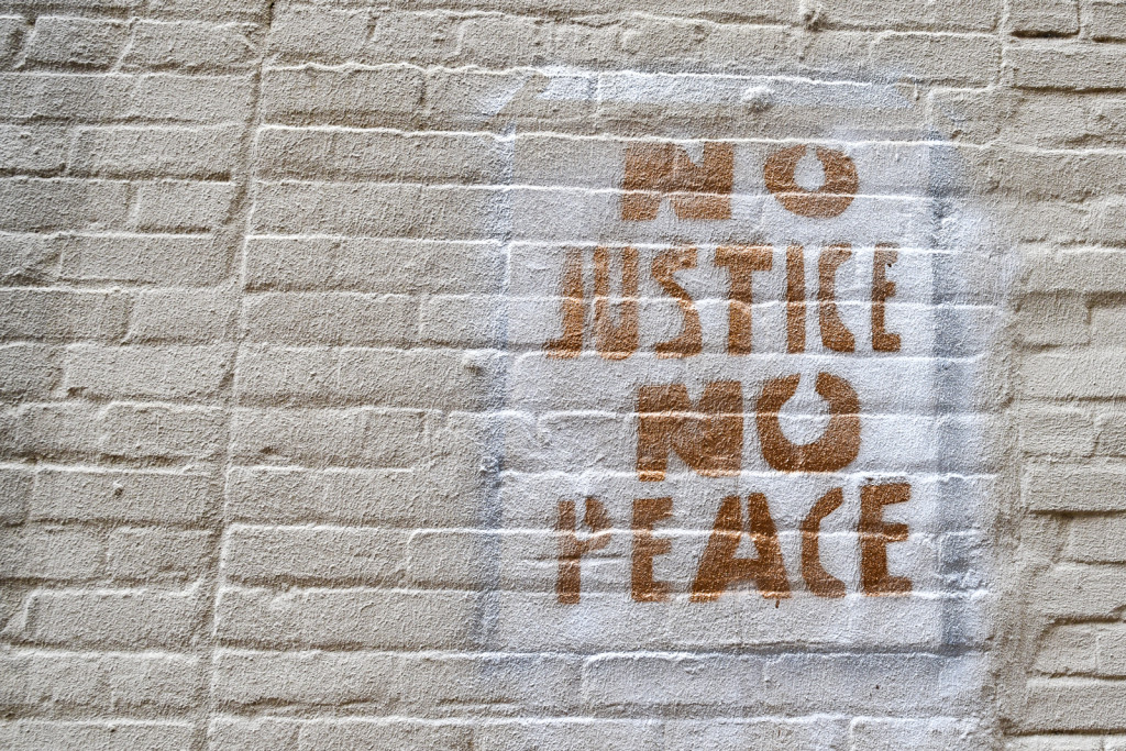 Graffiti on wall in Little Rock, Arkansas. Just Mercy: A Story of Justice and Redemption - Book Review
