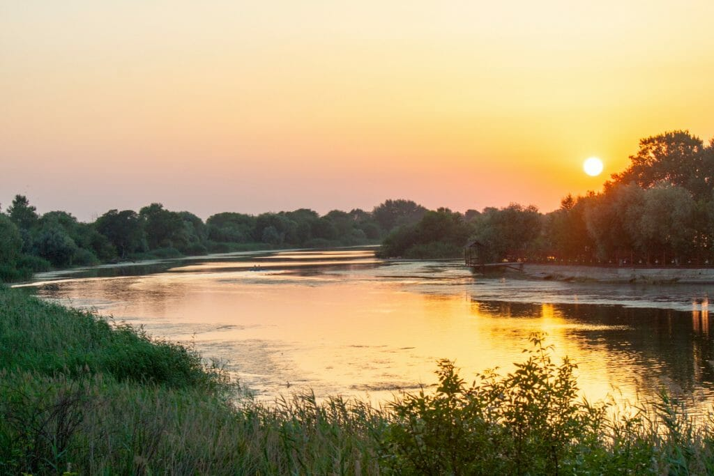 Photo of the Mississippi river at sunset. Dispatches From Pluto: Lost and Found in the Mississippi Delta - Book Review