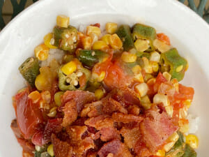 Okra, corn, and tomatoes sprinkled with bacon. Okra gumbo - one of our favorite recipes for tomatoes.