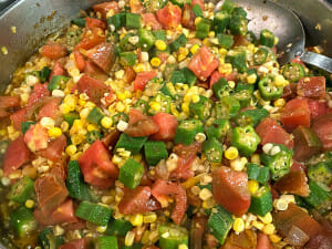 Okra, corn, and Tomatoes cooking in a skillt for okra gumbo!