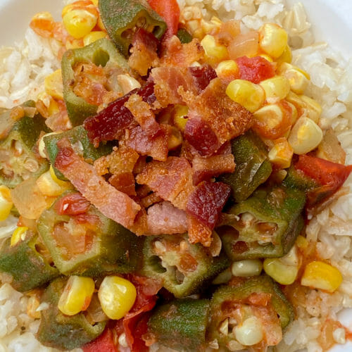 okra gumbo served over rice with bacon on top