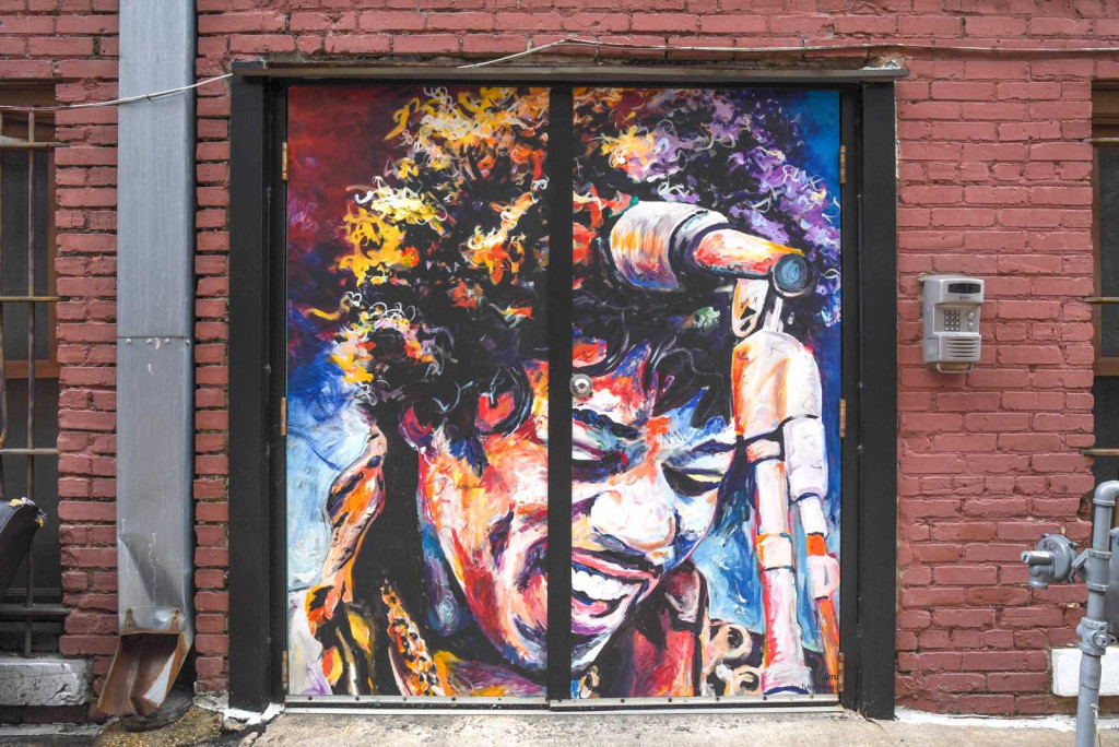 Jimi is one of the painted doors in Bakers Alley in Little Rock, Arkansas