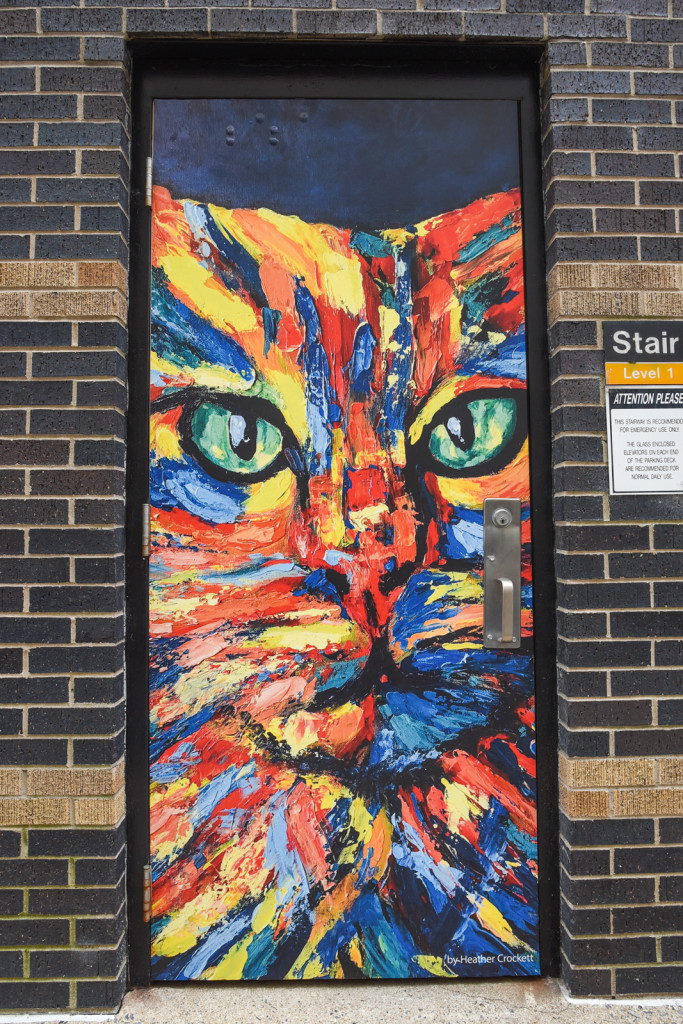 Jupiter is the name of the painting on one of the doors in Baker's Alley. One of the street murals in Little Rock, Arkansas
