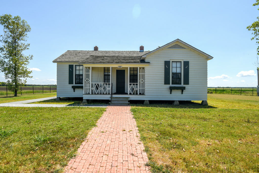 The boyhood home of Johnny Cash located in the middle of farmland in the Delta of Arkansas. The home is located near the town of Dyess Arkansas which was part of the WPA during the depression. The home is about 900 sq feet and is painted white with green shutters.