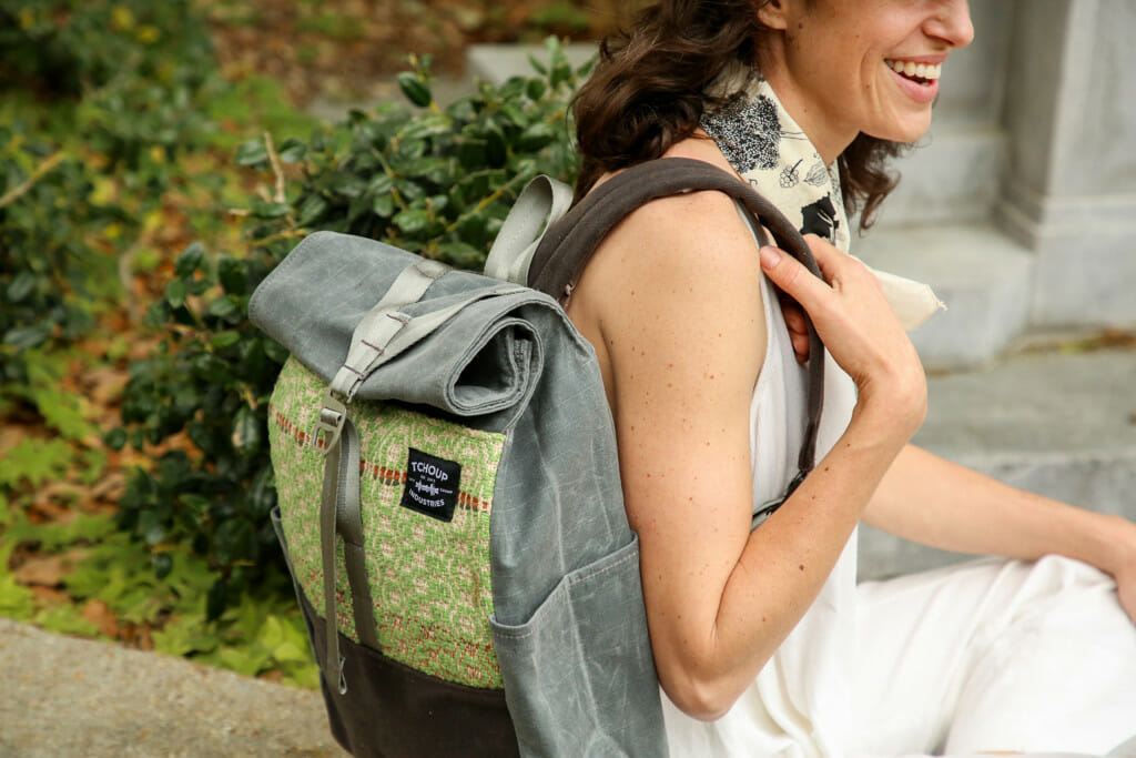 photo of a woman with a backpack. Tchoup Industries is a company that makes bags using locally sourced materials. They are based in New Orleans. Gifts from the south are the perfect gift to give this year.