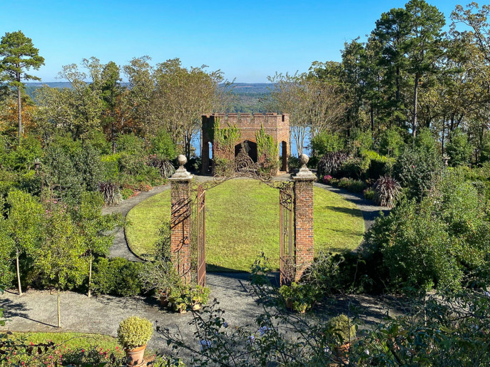 View of the English gardens and the Arkansas River from Moss Mountain Farm. Visit to Moss Mountain Farm is one of the best things to do in Little Rock.
