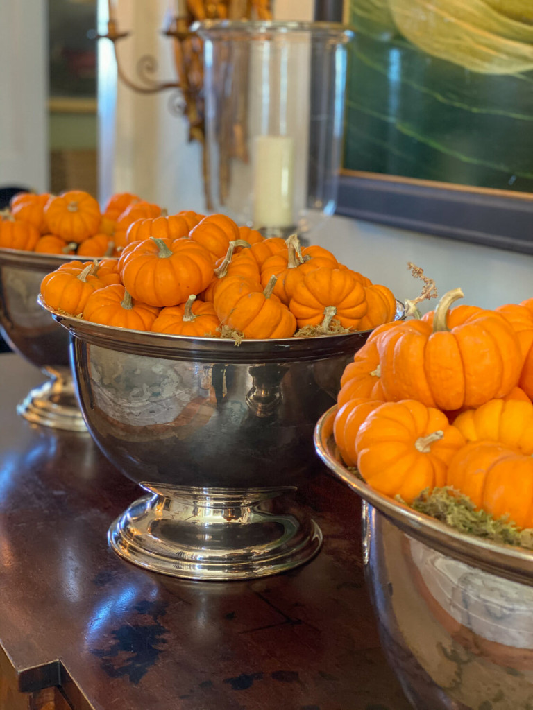 Fall decor with small pumpkins in large silver containers at the P. Allen Smith home