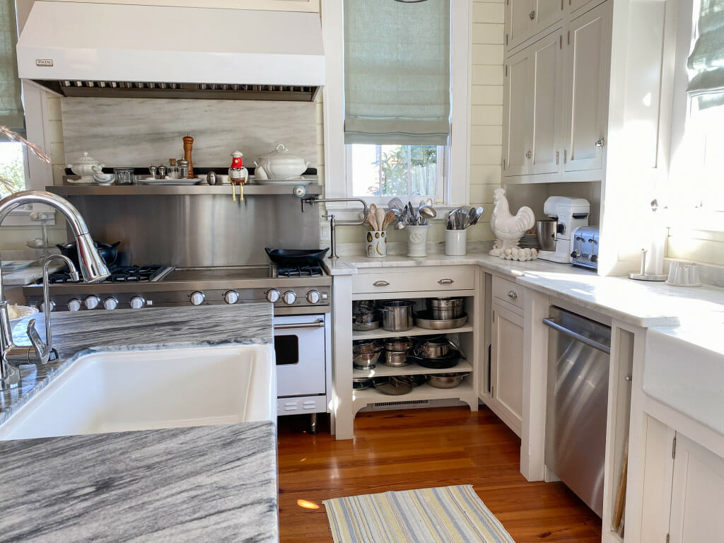 kitchen at the P. Allen Smith home. White cabinets, a white and stainless over and a grey and white counter top