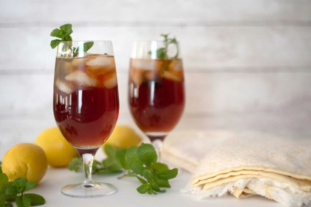 2 cups of tea with ice and a mint leaf. How to make the perfect southern sweet tea.