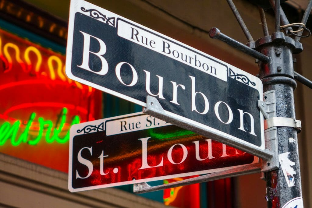 A close up of a sign in New Orleans. This is the corner of Bourbon Street and St. Louis Street.