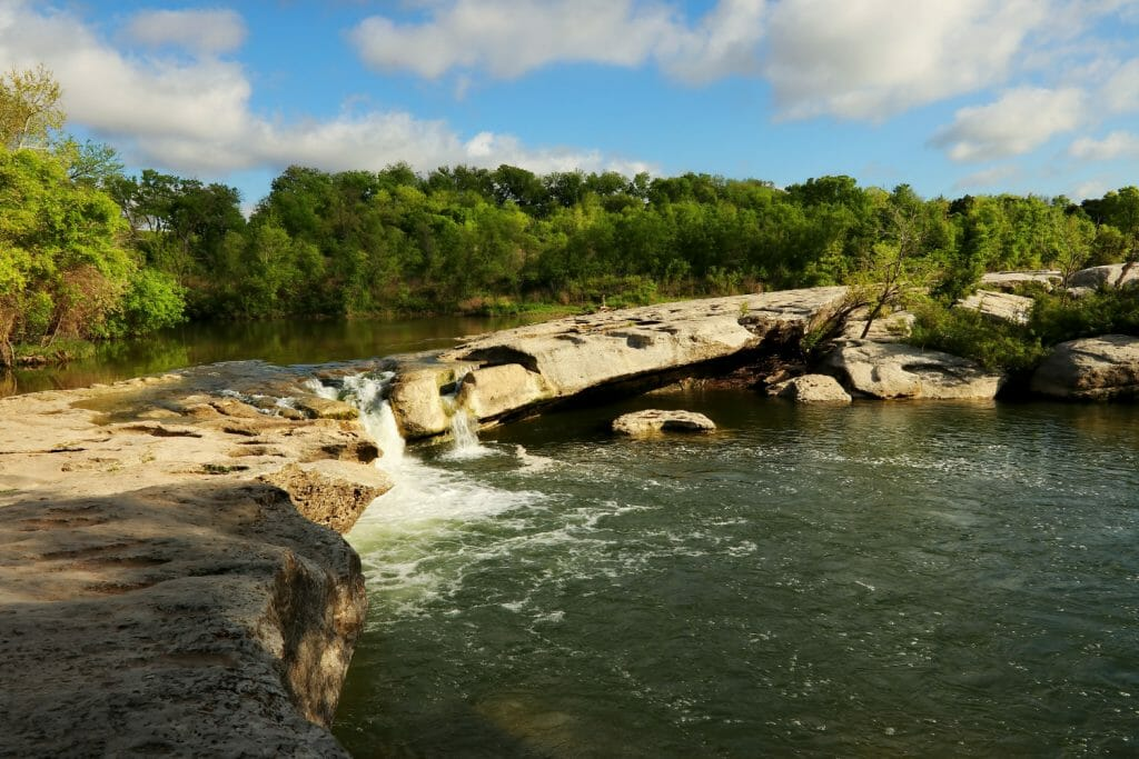 McKinney Falls State Park is located in the city limits of Austin. It has two swimming places. The upper falls and the lower falls. One of the best swimming holes in Texas Hill Country near Austin!