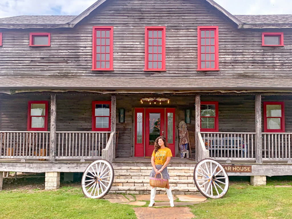 On the front porch of the Wander Inn which is a great place to stay in Round Top, Texas