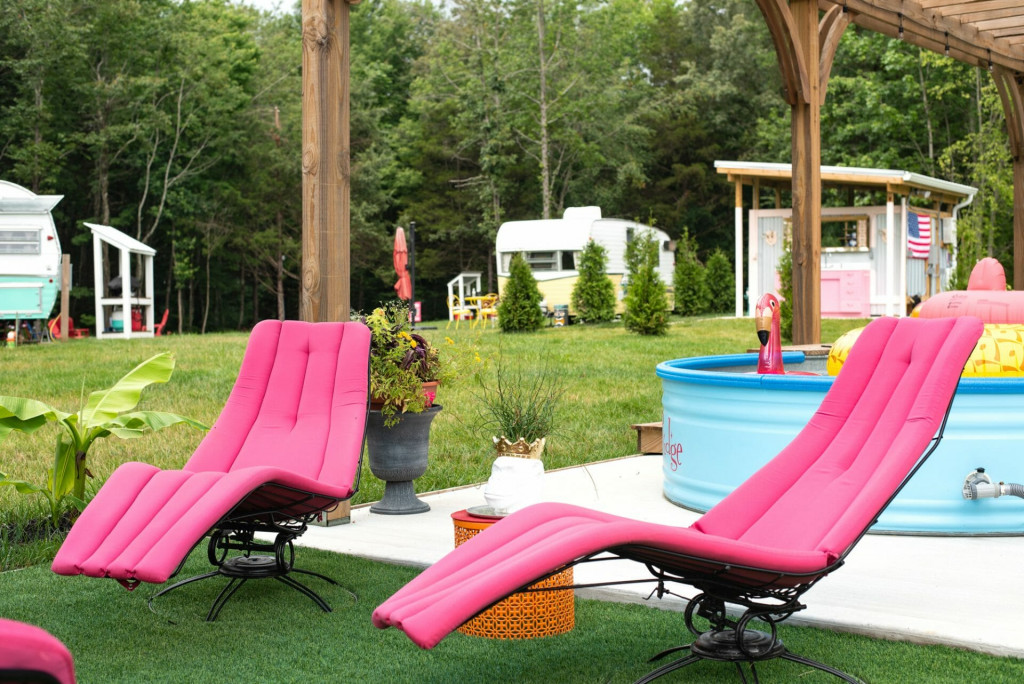 pink lounge chairs at the stock tank swimming pools