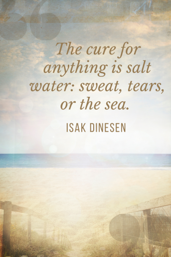 A quote with a blurred background. You can see stairs walking down to the sea. The cure for anything is salt water: Sweat, tears, or the sea Isak Dinesen