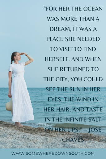 Quote about a woman going to the beach. The photo is a woman in a white dress looking out at the sea.