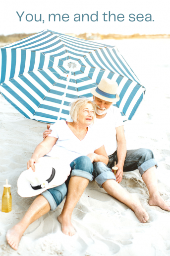 An older couple on the beach and the caption reads, You, me and the sea.