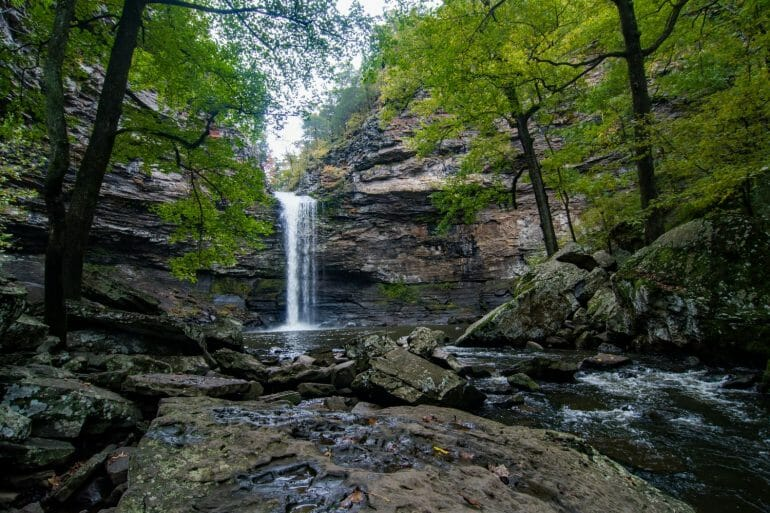 Cedar Falls Trail at Petit Jean Mountain State Park. Cedar Falls is one of the most popular hikes in Arkansas.