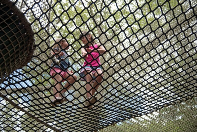 Playing on the ropes at the Nantahala outdoor center is a great Bryson City Activity.